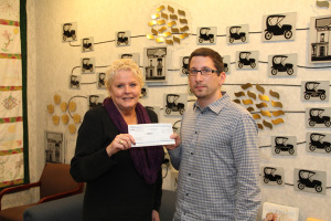 Presenting a check to Barbara Kohlhausen of Meals on Wheels